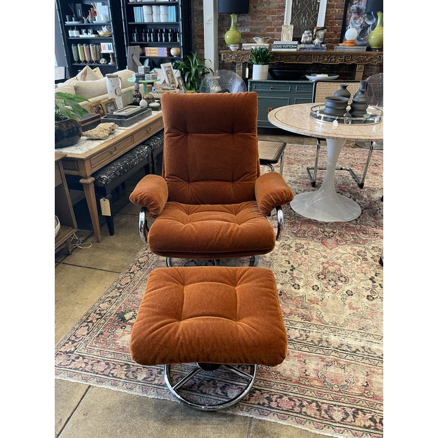 Vintage fully reupholstered 1990s ekornes lounge chair with foot stool. Original chrome swivel base. This makes a fabulous...