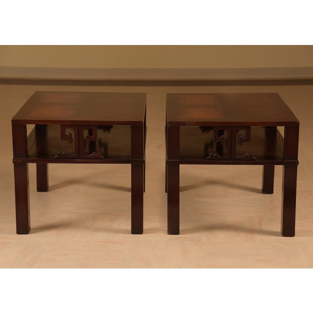 Two handsome mahogany end tables with Greek key motiffe on the sides and beautiful inlay cross design on the surface....