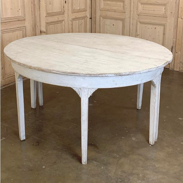 Early 19th Century Swedish Gustavian Period Painted Banquet Table is a marvel of understated elegance, and functional...