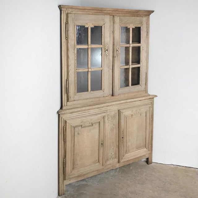 Grand 19th Century Country French Louis XVI Corner Cabinet was crafted on an unusually large size for such a piece,...