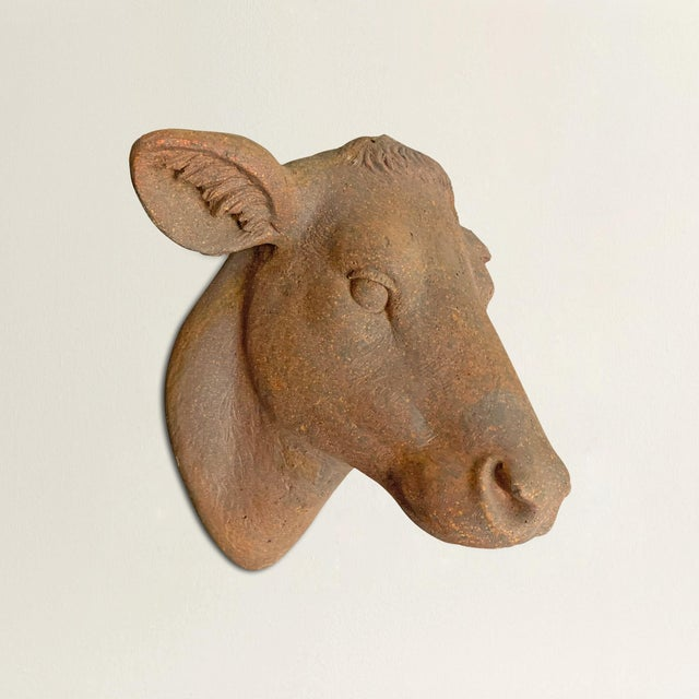A wonderful and whimsical American terra-cotta cow head reminiscent of antique French butcher's shop signs. Mounts to a...