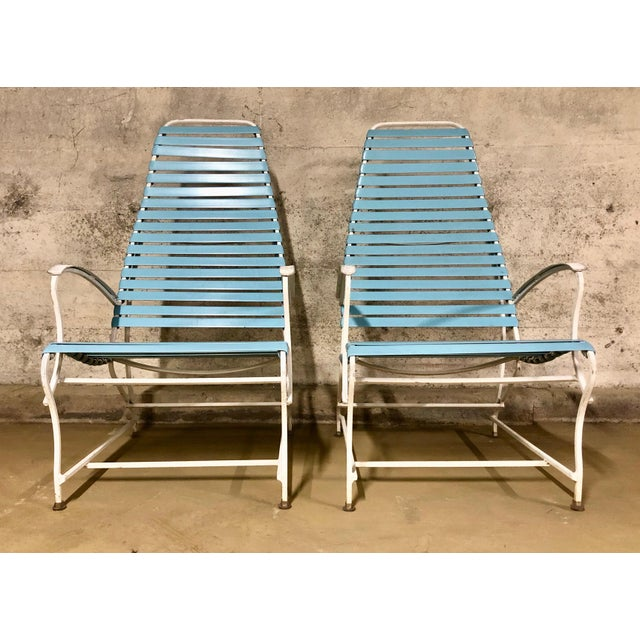 Fun Pair of Poolside Lounge Chairs from the 1950's. Frames are a cast aluminum and the straps are vinyl. The color is a...