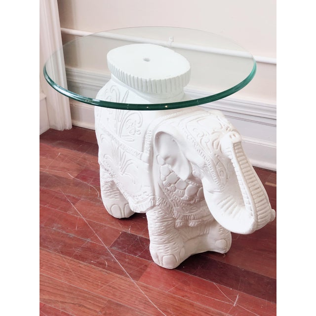 Fun, white elephant side table with trunks up! And round glass top. Beautiful carvings and detail. Wonderful condition...