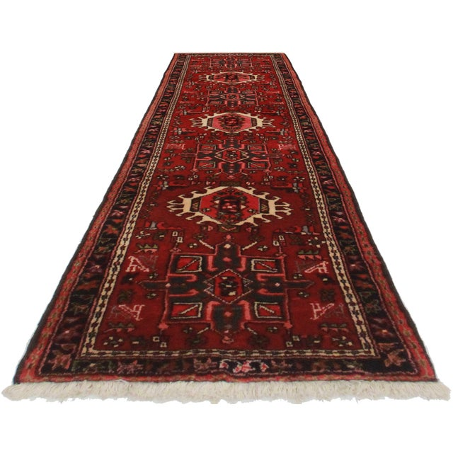 Hard to find unique and rare. Crafted of hand-knotted wool, this Persian Karajeh rug features an all-over geometric design.