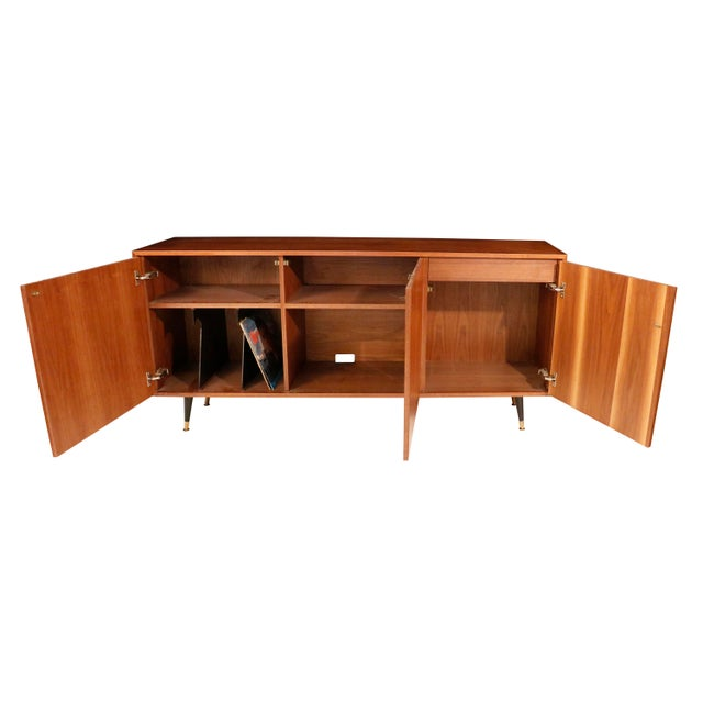 Mid-Century curated danish teak credenza/side board/console/record cabinet With 3 compartments. On the left side there a...