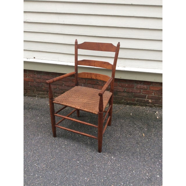 Great antique arm chair, 3 slat ladder back with turned and arched posts. One thing not found in a lot of true antique...