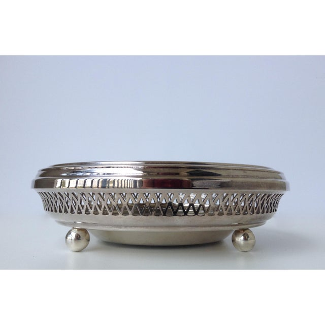 Vintage; Silver plate English, Celtic-Style,fretted design, with pierced top, on raised, ball feet, is this round warmer...