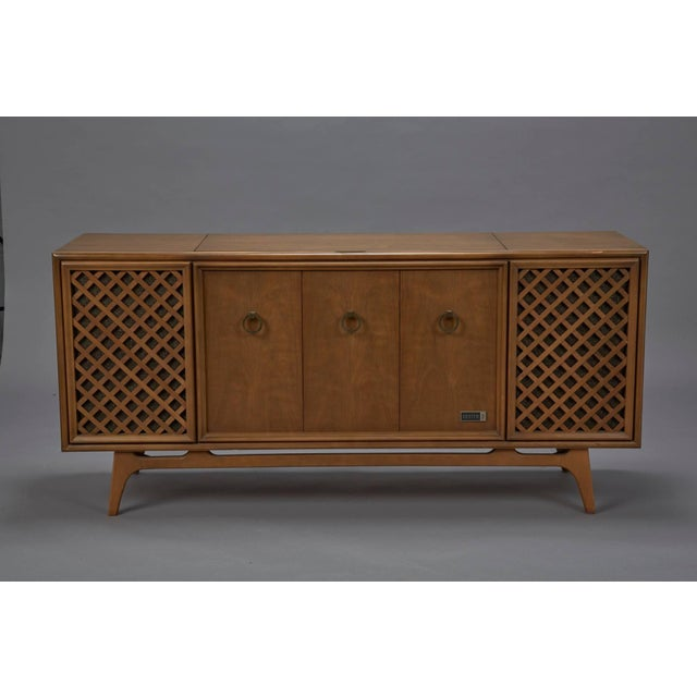 Zenith stereophonic stereo cabinet with record player and working radio. Produces rich, stereophonic sound. Minor fix to...