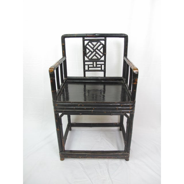 A stately mid-19th century Chinese Qing Dynasty (1644-1912) Lacquered bamboo chair. In excellent condition with age...