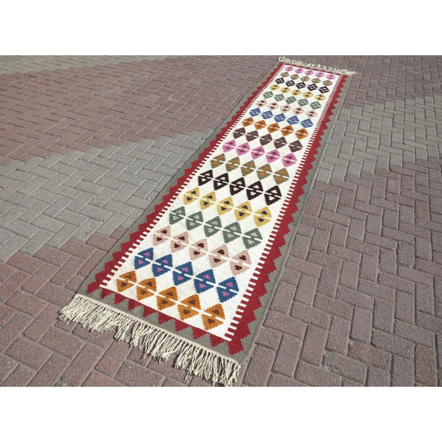 Beautiful vintage turkish kilim runner rug made pure handspun wool and dyed naturally. Beautiful colors. this vintage...