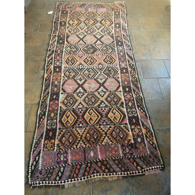 This exquisite Kilim rug in beautiful rich earthy tones is a chic addition to any room. Raw earthy color scheme and tribal...