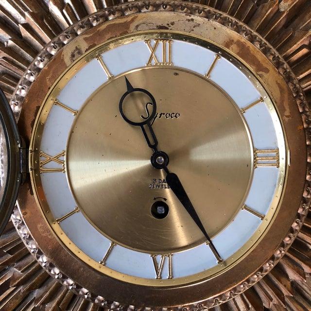 Vintage Syroco Wood sunburst wall clock.