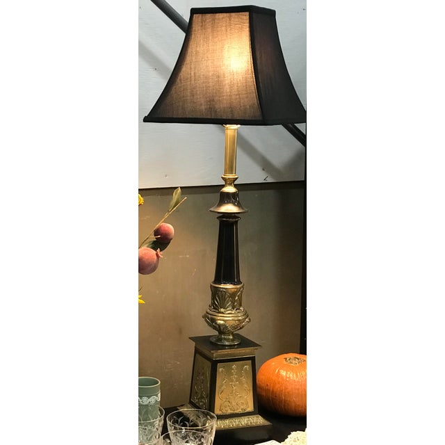 Wow!!! This pair of vintage lamps makes a statement. We think they definitely have a story to tell. With their black and...