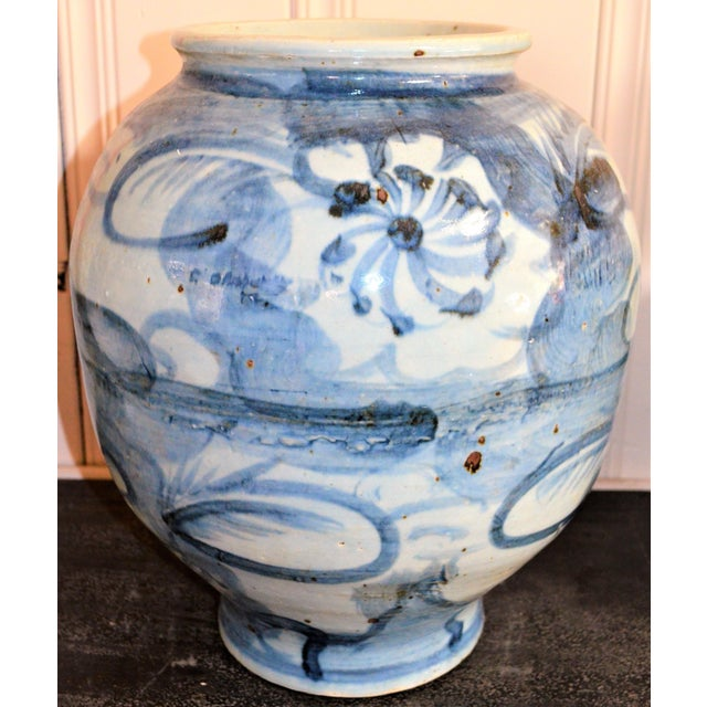 This is a beautiful blue and white large rounded abstract lotus flower porcelain vase. This has an amazing design and...