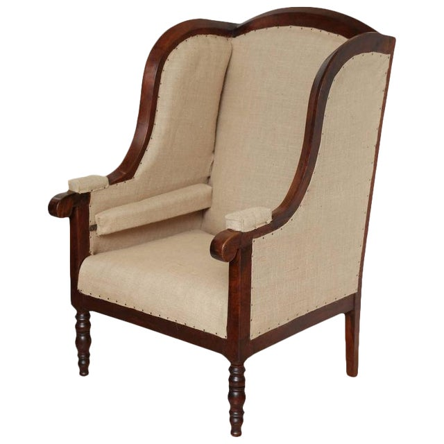 Early 19th Century French Walnut Upholstered Wing Chair For Sale