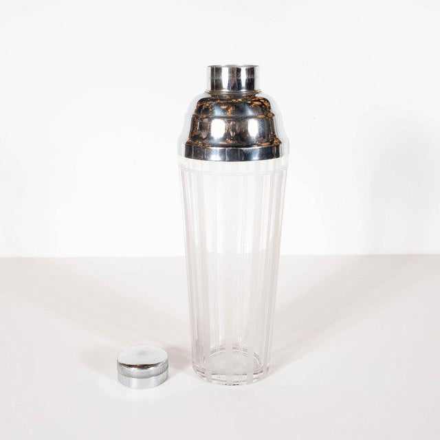 This sophisticated Art Deco cocktail shaker was realized in the United States, circa 1935. It features a gently expanding...