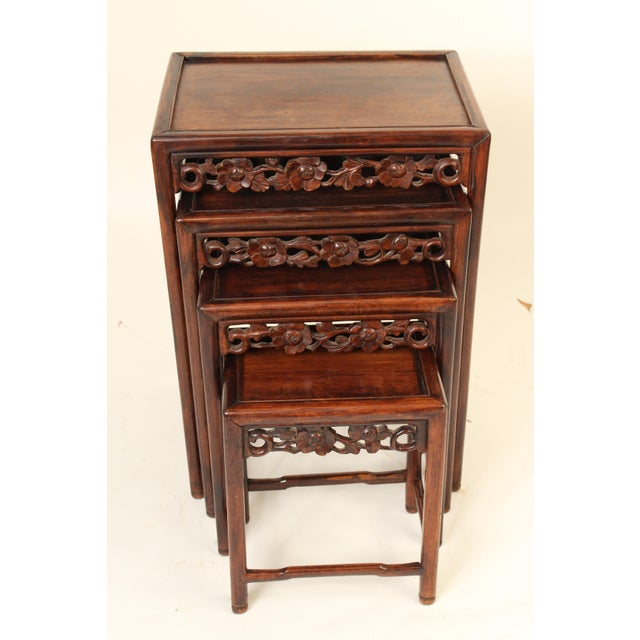 Nest of 4 Chinese carved teak wood tables, made circa 1930. The bottom of the largest table stamped China on the bottom of...