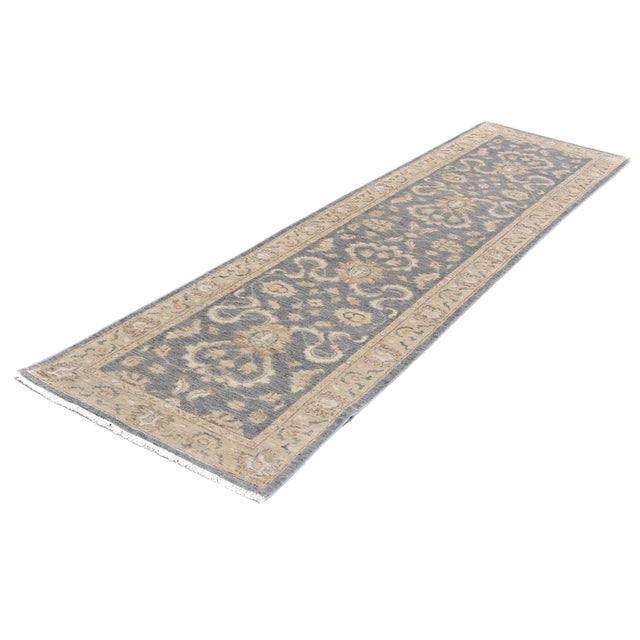 This dazzling runner has been hand-knotted in lustrous wool and designed intricately by skilled artisans' in a classic...