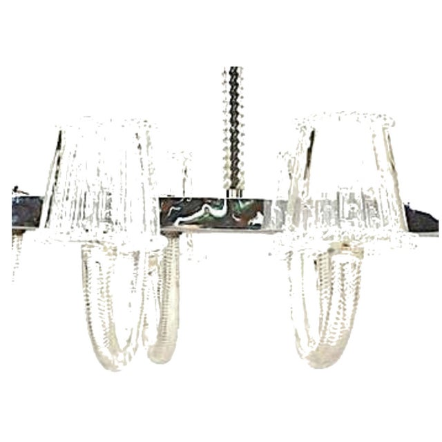 1940's Italian Murano clear swirl design glass 10 arm chandelier emanating from a rectangular chrome frame holding clear...