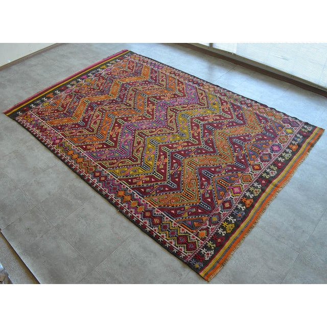 An antique Turkish Kilim handwoven braided jajim rug made of hand spun wool on wool and natural dyes. The condition is...