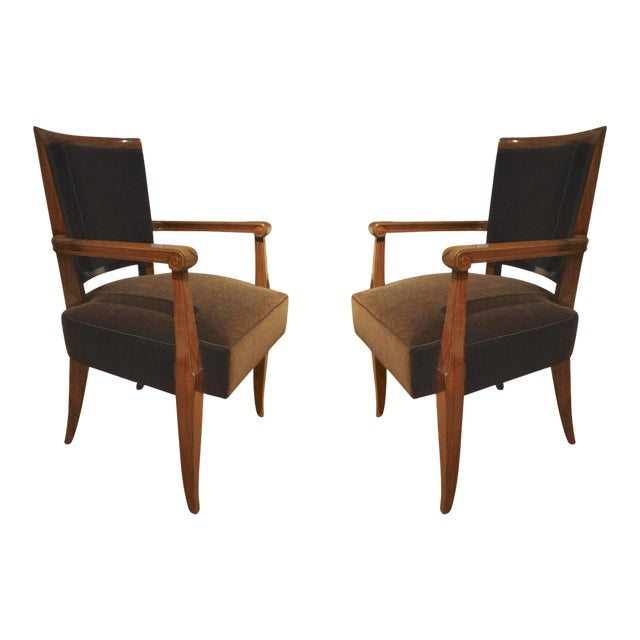 Maxime Old pair of refined solid walnut arm chairs.