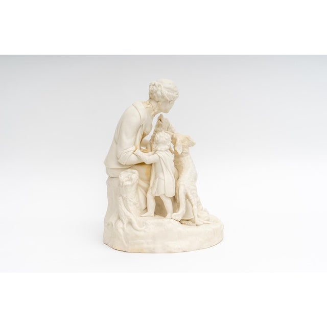 This fine figural composition features a maiden and child, together with their hunting dogs. For trade price or more...