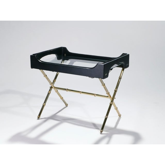 Golden brass and masculine black leather are stunning together in this table by French Art Deco modernist designer Jacques...