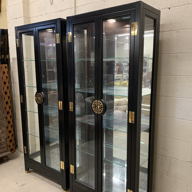 Amazing pair of American of Martinsville lighted glass and black lacquer curio China cabinets. If you know, you know....