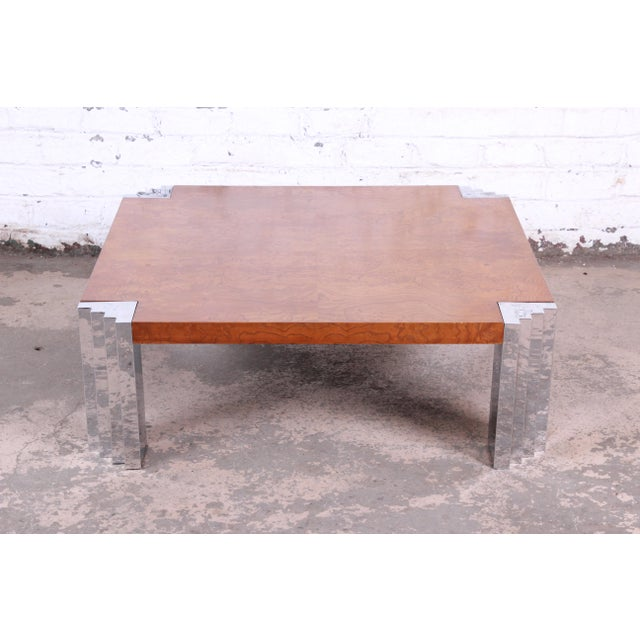An exceptional mid-century modern burl wood and chrome cocktail table attributed to Milo Baughman for Thayer Coggin. The...