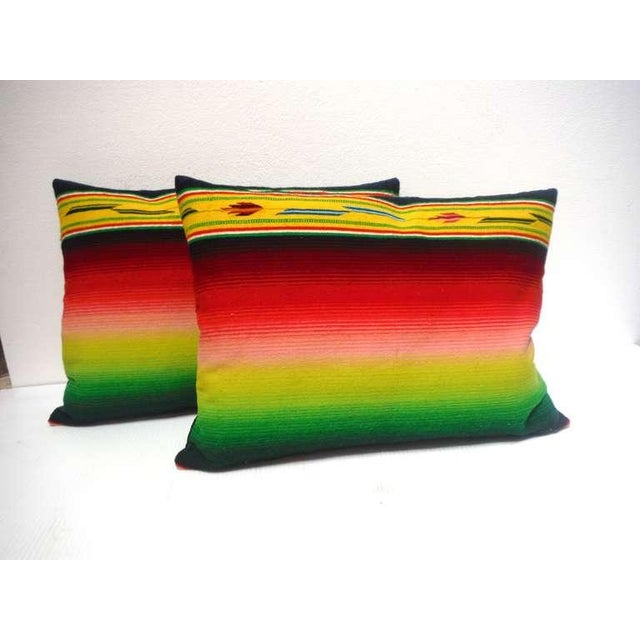 This very interesting and bold colors are made from a great early Mexican Indian serape with a black cotton linen backing....