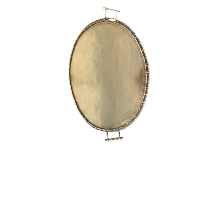 """This is a very large faux bamboo brass tray with a brass folding stand. It is 35"""" from handle to handle and 22"""" wide. The..."""
