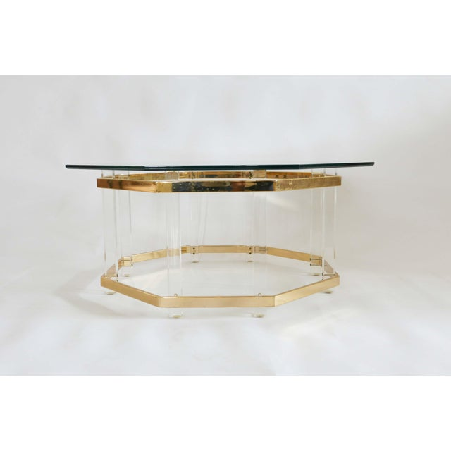 Midcentury modern style coffee table in Charles Hollis Jones designer type style. Octagon shape. Glass rests on base.