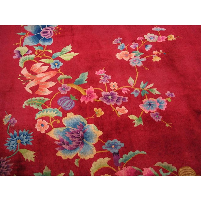 "This is a Chinese art wool rug from China 1930. The size is 8'9""x11'6"". The color is red and the patterns are in blue,..."