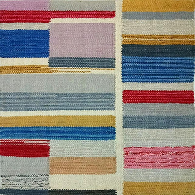 Our Artful Kilim collection takes graphic color-blocking and softens it with the painterly effect of the handwoven...