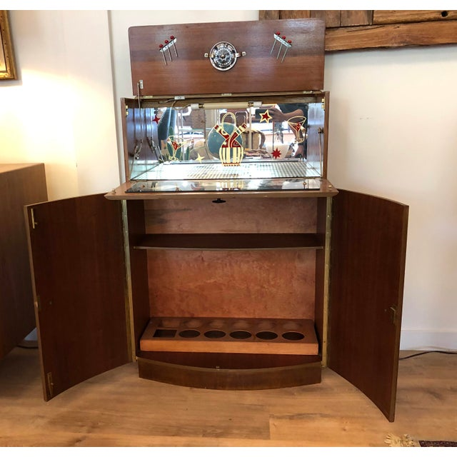 Unique and rad drop-door liquor cabinet with skeleton key, 6 bar pics, and citrus juicer. The light, although not wired,...
