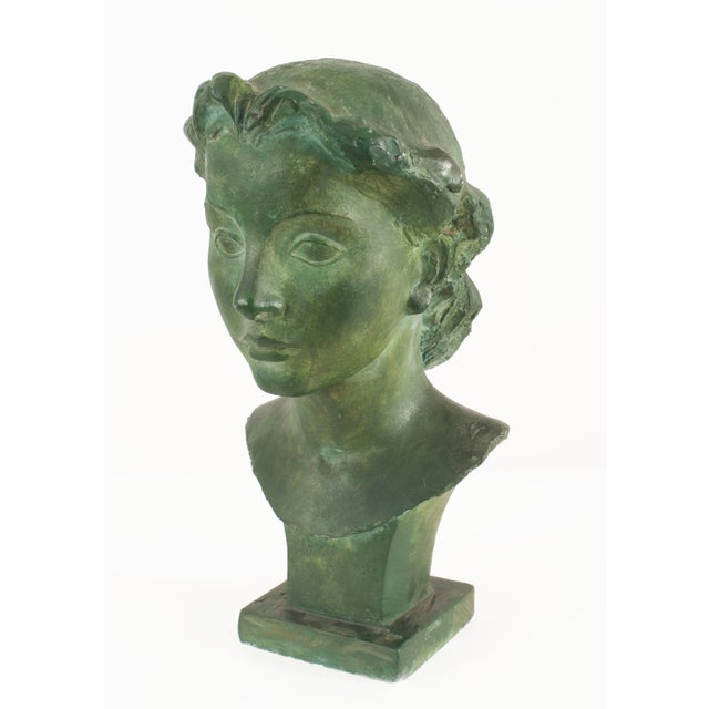 (PRICED EACH) 2 French Art Deco (1930s) green patina plaster busts of young women (signed: VADIM ANDROUSOV)