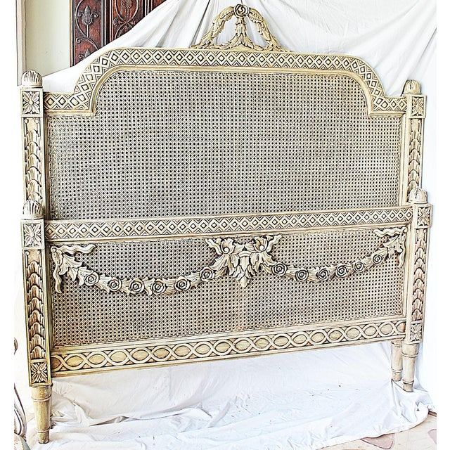 Strong take on a classic Louis XVI style queen-sized headboard and footboard, double caning on all sides, all handcarved...