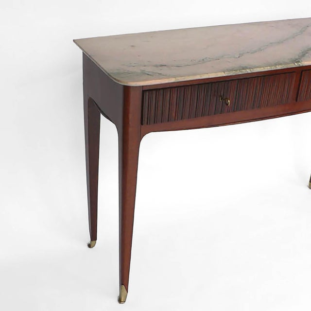 A very elegant modernist console table executed in mahogany with two drawers having fluted rosewood facades, the extremely...