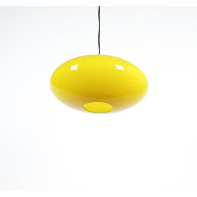 "Yellow Stilnovo Glass Ball Pendant Lamp, Midcentury Italy, circa 1955. Beautiful 17"" Italian pendant light with black..."