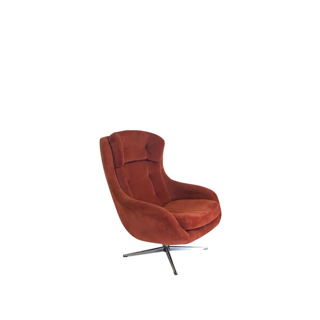 Super cool, super comfy swiveling Overman Egg chair with rusty colored corduroy. There are two small blemishes on the...