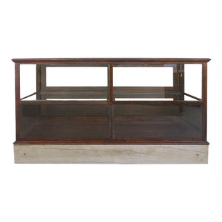 1930s Mid-Century Modern Wood & Glass Showcase Counter With Stone Supports at Base For Sale