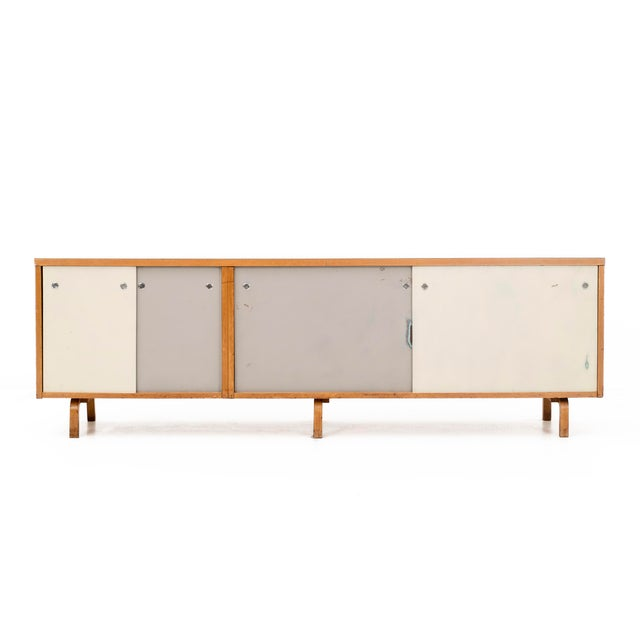 Thonet case on bentwood legs, featuring sliding doors and multiple adjustable shelves.