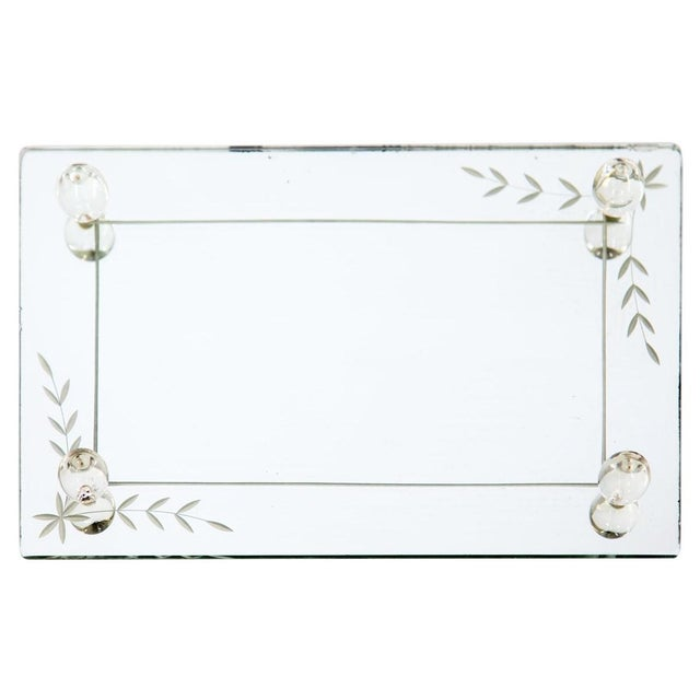 Rectangular etched glass mirrored vanity tray with decorative glass balls, c. 1950s. A linear frame etched from under the...