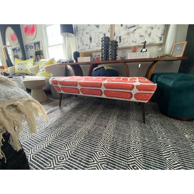 Arteriors Home Caprera Muslim bench custom upholstered in Anthony George Fabric. A modern/retro addition to any space.
