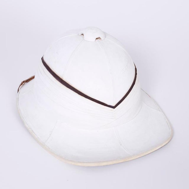 Antique English pith helmet and painted copper box with all the historical romance you could wish for. Originally...