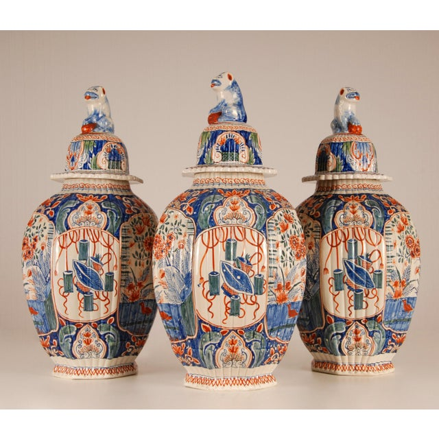 Edme Samson Dutch Delftware A garniture of three antique polychrome Reeded Ovoid Vases and Covers A garniture of vases in...
