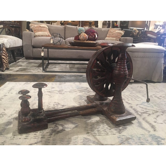 Antique Spinning Wheel featuring naturally distressed red paint. It is in great condition. The wheel spins perfectly so it...