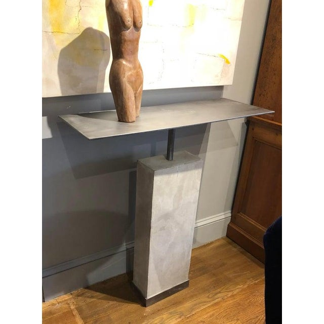 Mid-century modern style console table based on an original 1960s design. Made of limestone with brushed steel tops....
