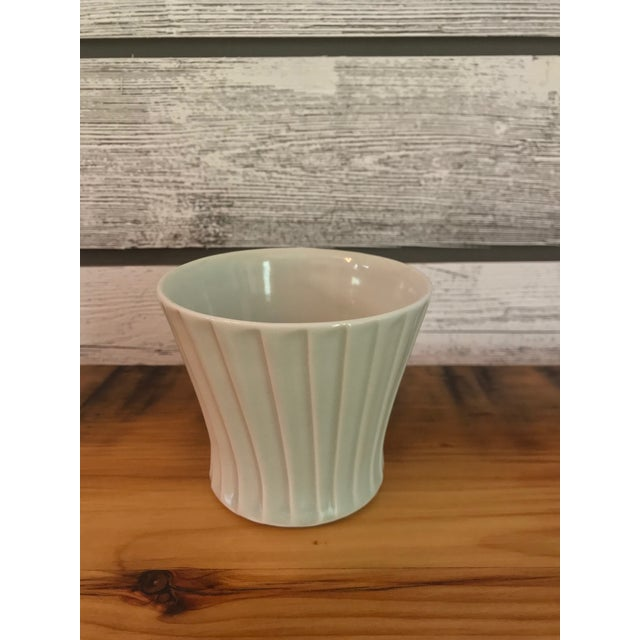 Artist signed, sage grey, fluted stoneware cup or small vase.