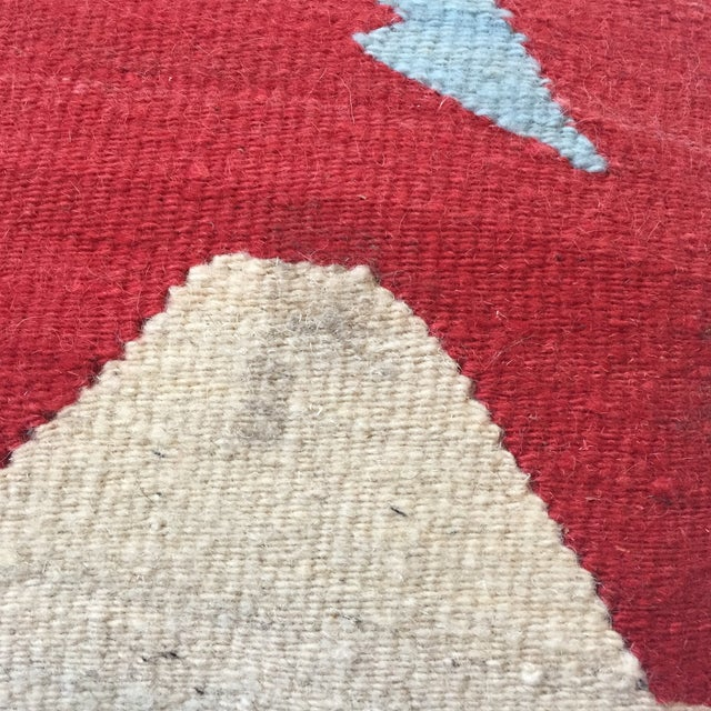 Southwestern style accent pillow made out of woven wool in a rug pillow fashion with canvas backing. Comes with non-...